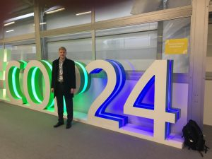 JBA at COP24 - John with big conference sign
